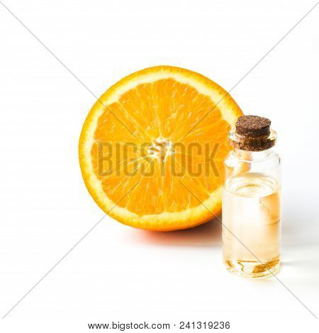 Orange Slice Fruit And Bottle With Oil Or Essence. Round Sliced Isolated On White. Close Up.