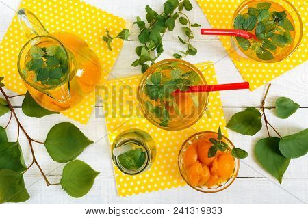 Summer Cold Drinks. Delicious Refreshing Drink With Apricot And Mint In Glasses On A White Wooden Ba