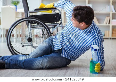 Disabled man on wheelchair cleaning home