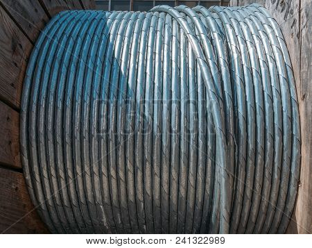 New Twisted Steel Cable Coil Wire Or Steel Rope, Industrial Metallic Cable Line In Roll.