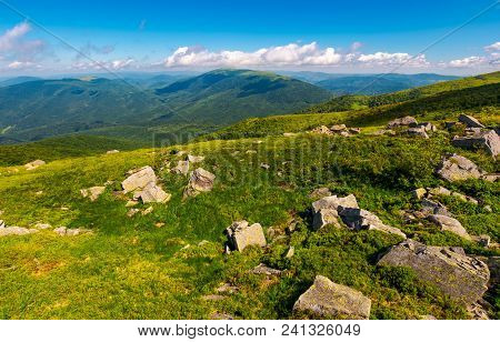 Fresh Summer Forenoon Scenery In Mountains. Beautiful With Boulders On The Grassy Hill Under The Blu