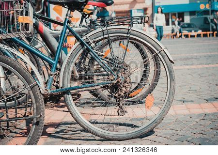 Old Bicycles Parked In The City In The Parking Lot