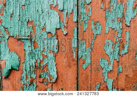 Background, Texture, Paint. Old Paint. Peeling Paint..part Old Green And Red Wood Doors. Cracks.