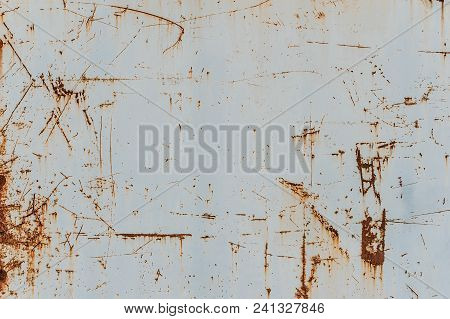 Metal Background With Rust. Rust Stains. Corroded Spots On The Metal Surface.old Rusty Painted Metal