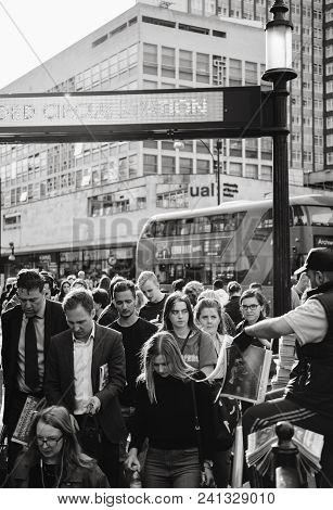 London, United Kingdom - May 18, 2018: Old Circus Station Man Distributing Latest Braking Royal Wedd