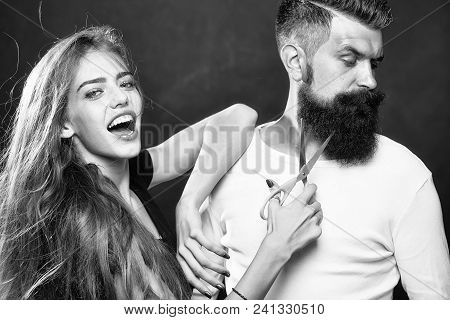 Closeup View Of Young Beautiful Couple Of Beautiful Fashionable Female Barber Cutting And Holding Sc