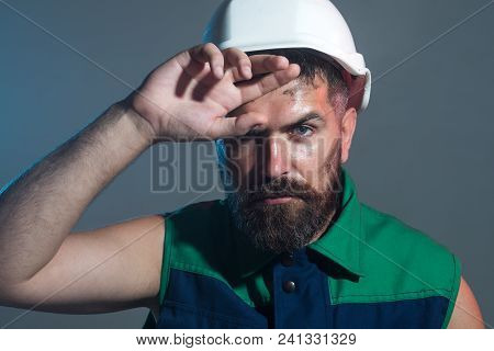 Male Builder. Construction Worker In Hard Hat. Business, Building, Industry Concept - Builder In Har