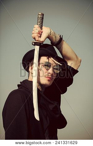 Man Face Handsome. Beauty Fashion Model Girl. Fashion Look. Warrior In Sunglasses, Black Hat And Clo