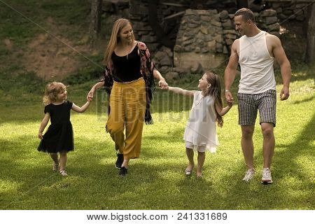 Child Childhood Children Happiness Concept. Childhood. Girls, Woman And Man Smile On Summer Landscap