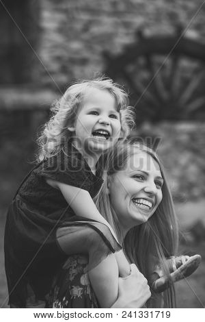 Child Childhood Children Happiness Concept. Childhood. Girl Child Smile On Woman Shoulders On Summer