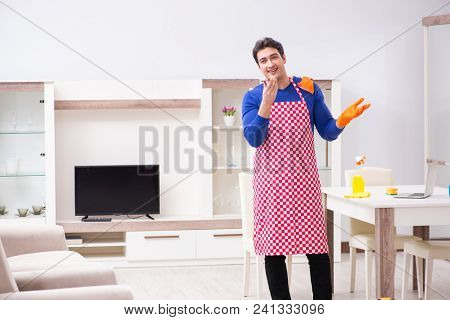 Contractor man cleaning house doing chores