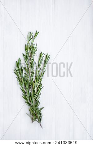 Background Rosemary On A Wooden Table