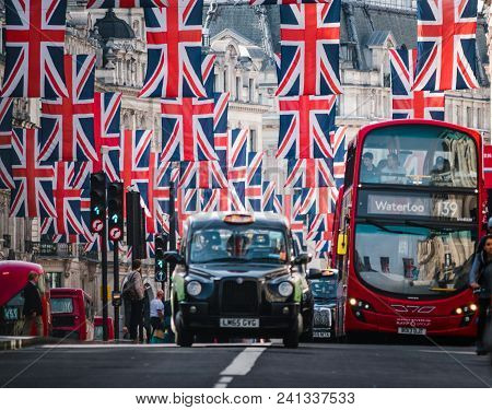 London, United Kingdom - May 18, 2018: London Rede Bus Under Union Jack Flags On Regent Street A Day