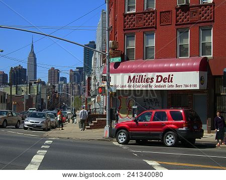 Queens, New York - April 2: A View Of Jackson Avenue And Distant Manhattan Skyscrapers On April 2, 2
