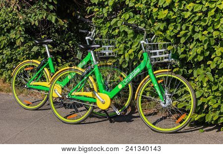 Zurich, Switzerland - May 11, 2018: Two Limebikes Parked On The Street. Limebike Operates A Fleet Of