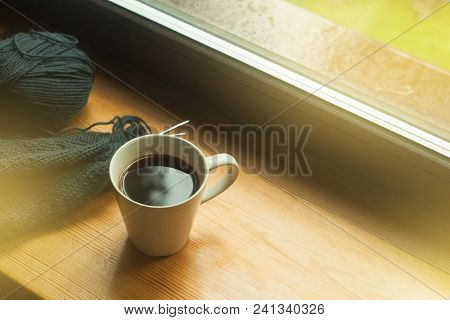 Cup Of Coffee And Knitting On Windowsill, Cozy Morning, Toned Photo
