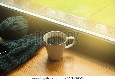 Coffee Cup And Handmade Work Knitting On A Sunny Day Window Background, Toned Photo