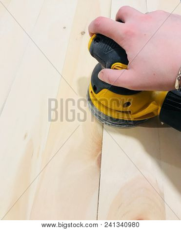 Sanding wood with a electric sander