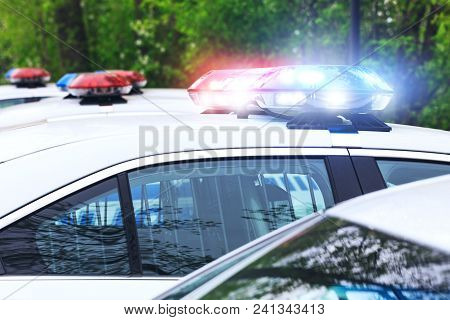 Some Police Cars With Focus On Siren Lights. Beautiful Siren Lights Activated On A Police Car Before