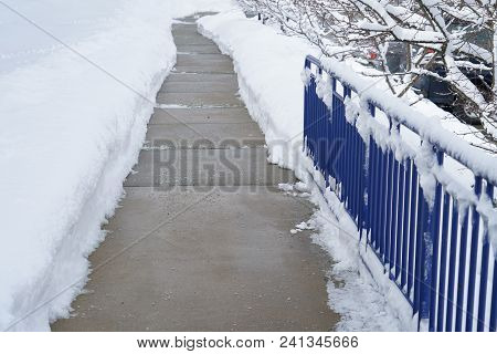 Sidewalk With Snow Removed Outside The Building
