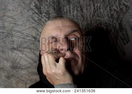 Studio Portrait Of Unsure Man With A Side Gaze, Selective Focus Closeup