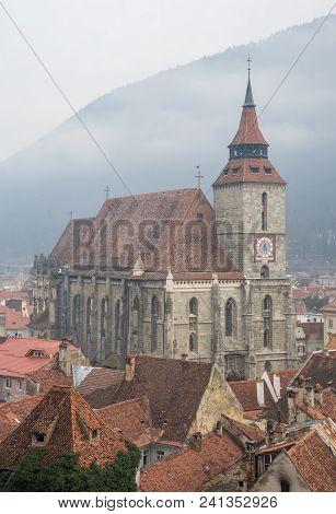 Black Church In A Brasov Old Town In A Foggy Winter Day. Transylvania, Romania
