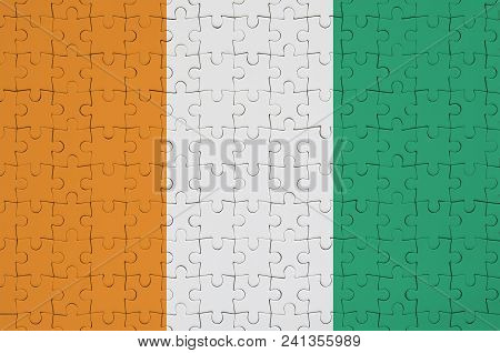 Ivory Coast Flag  Is Depicted On A Folded Puzzle
