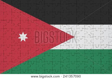 Jordan Flag  Is Depicted On A Folded Puzzle
