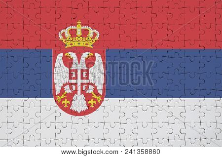 Serbia Flag  Is Depicted On A Folded Puzzle