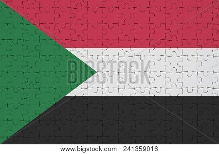Sudan Flag  Is Depicted On A Folded Puzzle