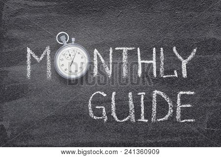 Monthly Guide Handwritten On Chalkboard With Vintage Precise Stopwatch Used Instead Of O