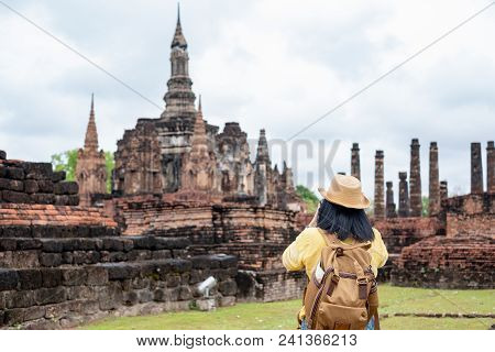 Asian Tourist Woman Take A Photo Of Ancient Of Pagoda Temple Thai Architecture At Sukhothai Historic