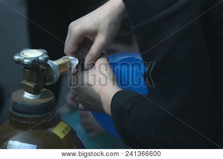 Working Process Of Inflating A Balloon With Gas Helium From A Metal Gas Cylinder