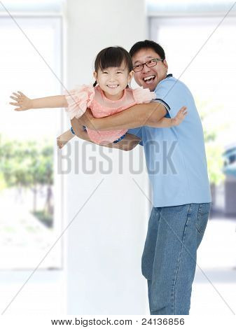 happy asian father and little girl playing together