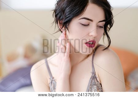 seduction sexual pleasure and delight concept. young sexy horny hot sensual sexually aroused brunette girl in lingerie in her bedroom poster