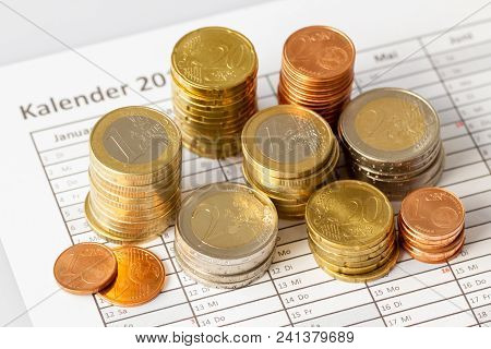 Euro Coins In Pile On Appointment Book, For Background. Germany