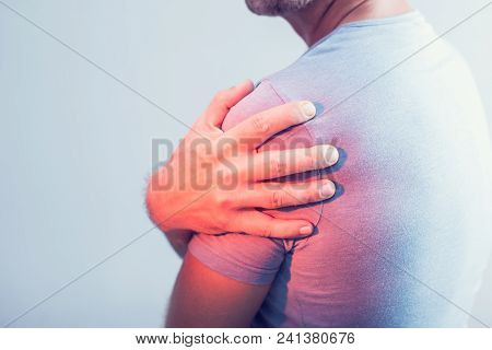 Close Up Of Man With Shoulder Pain Or Neck Pain On White Background,health Concept