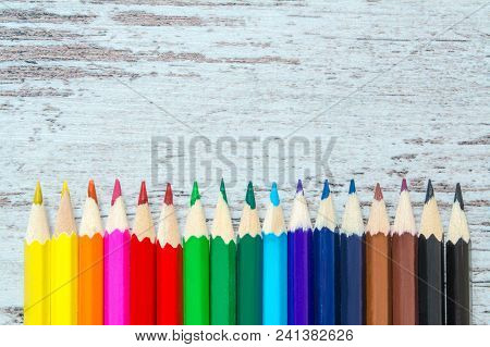 Colored Multicolored Pencils Close Up Macro Down On A Vintage Wooden Background, Wooden Worn Boards