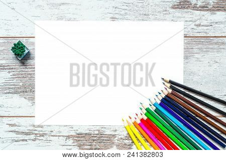 Colored Multicolored Pencils, A Sheet Of White Paper Isolated On A Vintage Wooden Background, Wooden