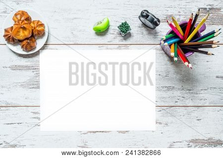 Colored Multicolored Pencils In A Cup, A Sheet Of White Paper Isolated, Old Style Clock, Plate With