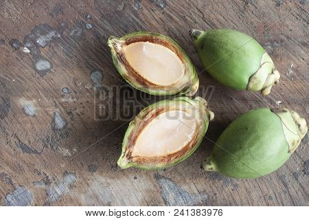 Foxtail Palm Fruit On Wooden Floor For Background, Soft Fruit To Boil Syrup Ready To Eat, Dissect Of