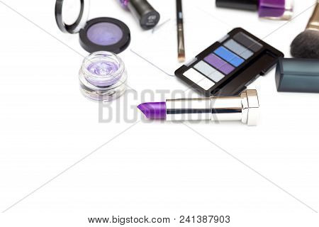 Set Of Make-up Cosmetics For Violet Make-up On A White Background. Copy Space