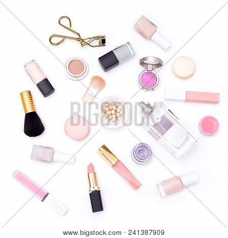 Decorative Cosmetics Of Pink Color On A White Background. View From Above