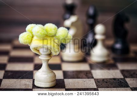 Chess Pawn In Foolish Hat - Business Failure Concept If Works Alone Without Team And Opposes Itself