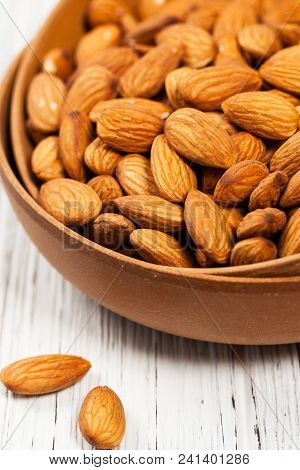 Organic Raw Almonds Nuts Background. Selective Focus.