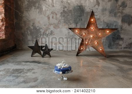 Dark Blue Birthday Cake With White Decor And Number 1 On Concrete Wall Background And Star. Horizont