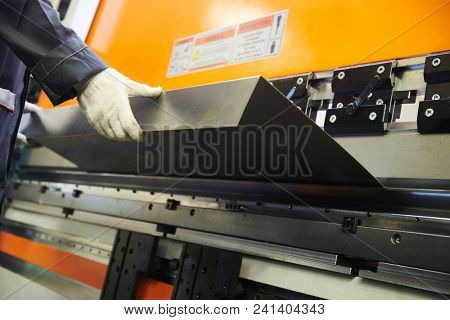 metal sheet bending machine at work in factory