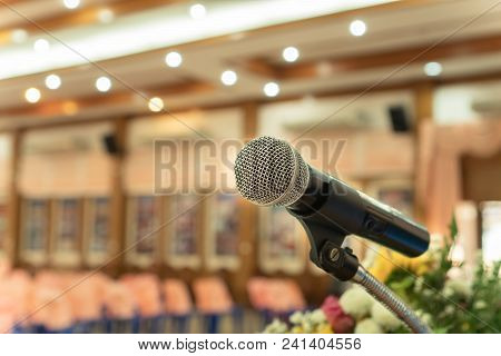Microphones On Abstract Blurred Of Speech In Seminar Room Or Front Speaking Conference Hall Light, C