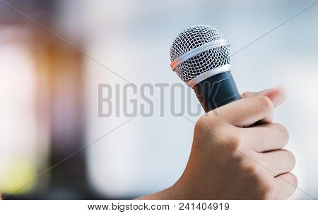Semiar Conference Concept : Hands Holding Businesspeople Speech Or Speaking With Microphones In Semi