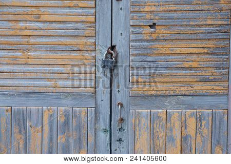Wooden Door With A Lock On An Old House